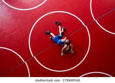 Overhead view of wrestlers in a gut wrench position