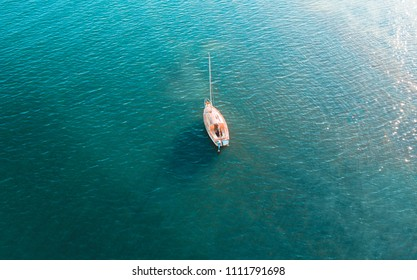 Overhead view of yacht on beautiful blue waters