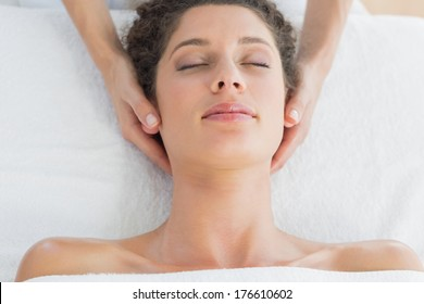 Overhead view of young woman receiving massage in health spa