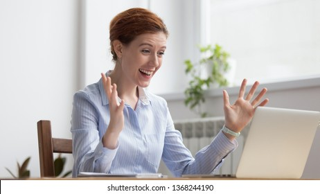 Overjoyed happy business woman winner looking at laptop celebrating great professional work result corporate success, excited motivated office manager receive good news online get promoted rewarded