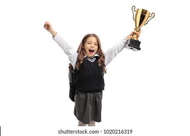 Overjoyed schoolgirl holding a golden trophy isolated on white background