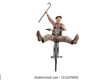 Overjoyed senior with a cane riding a bicycle isolated on white background