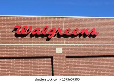 Overland Park, Kansas / USA - November 18 2019: Sign for Walgreens Pharmacy on Side of Building beneath Blue Sky