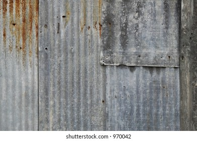 overlapping pieces of worn and rusted metal