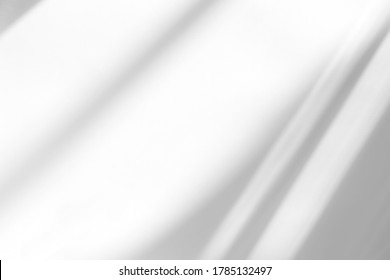 Overlay effect for photo and mockups. Organic drop diagonal shadow and rays of light from window on a white wall. shadows for natural light effects