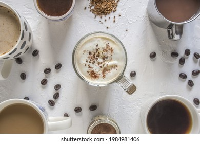 An overlay picture with 6 mugs in different sizes  All full of drinks such as hot chocolate, coffee, americano, cappuccino, and affogato