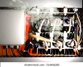 Overloaded electrical circuit causing electrical short and fire.
