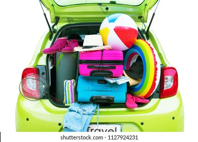Overloaded Luggage Carrier of Green Car Bright Suitcases Summer Accessories Things Slippers Hat Ballon Rackets. Concept Summer Holiday Travel Family Trip Background Isolated on White