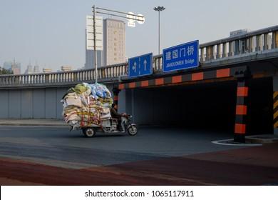 Overloaded motorbike in Beijing China