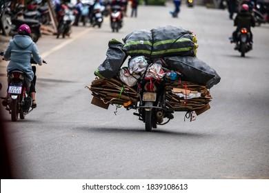 A overloaded motorcycle in Ha Giang in Vietnam, 13. November 2019