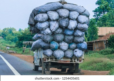 Overloaded Track with the Bagfuls on the Road, Cotonou, Benin