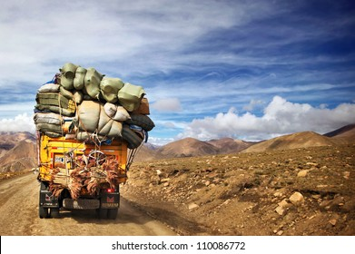 Overloaded truck on road in Himalayas