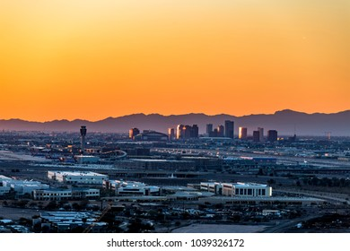 An overlook from atop Mountain Butte of sunset over downtown Phoenix Arizona