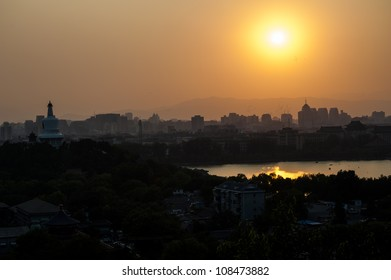 Overlook of Beijing city at the hill of Jingshan park during the sunset