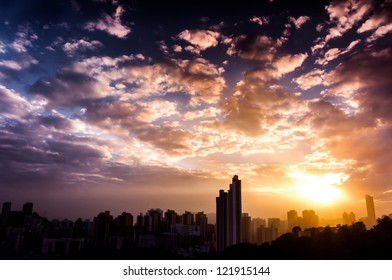 overlook of dramatic sunset and beautiful clouds pattern with blue sky over hong kong city skyline