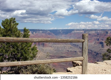 Overlook of the Grand Canyon against a blue cloudy sky