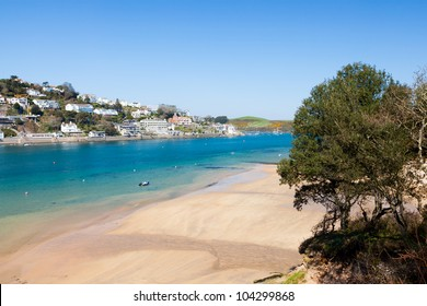 Overlooking the beach at Mill Bay on the Salcombe Estuary, Devon England UK