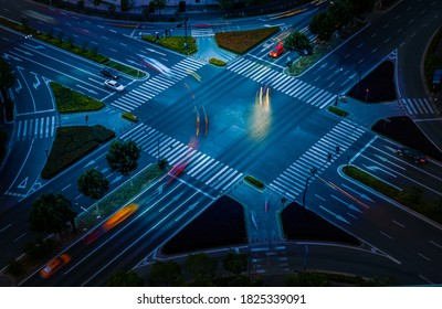 Overlooking the city's ten road traffic intersection markings and driving vehicles
