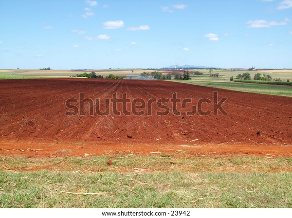 Overlooking a country farm with irrigation system going in the background
