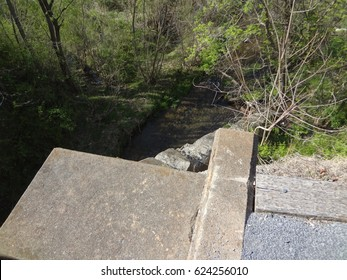 Overlooking a creek and forest from a bridge on a bright and sunny day. East Tennessee, USA.