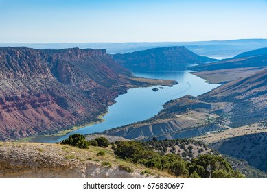 Overlooking Green River from the Flaming Gorge Green River Scenic Byway in Utah showing red-colored mountains and high desert plant life