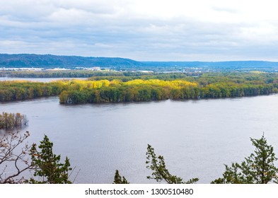 overlooking mississippi river and wooded islets from atop bluffs in iowa and wisconsin in distance