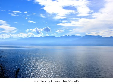 Overlooking the mountains behind Lake Baikal, Russia on a beautiful blue sky day.