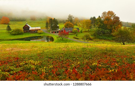 Overlooking a peaceful New England Farm in the autumn on a fog day, Woodstock, Vermont, USA