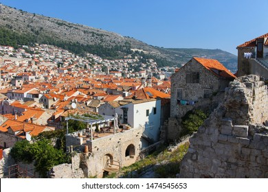 Overlooking the red rooftops of Dubrovnik from the surrounding ancient city wall in Croatia, Europe