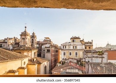 overlooking the rooftops of Rome, historic palaces, Catholic churches and old houses