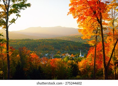 Overlooking Stowe Community Church sitting amongst the tranquil village of Stowe on a spectacular autumn sunset with Mt. Mansfield in the background, Stowe, VT, USA.