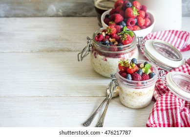 Overnight oats (Bircher muesli) with berries for healthy beautiful breakfast, space for text