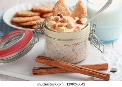 Overnight oats with cinnamon, hazelnuts, mango yogurt, and Swedish oatmeal cookies