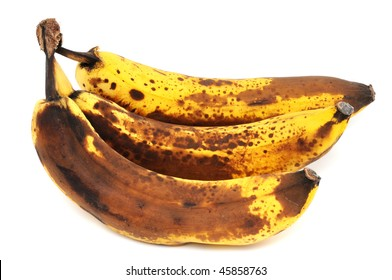 Overripe bananas in front of a white background