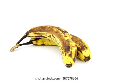 overripe bananas on a white background