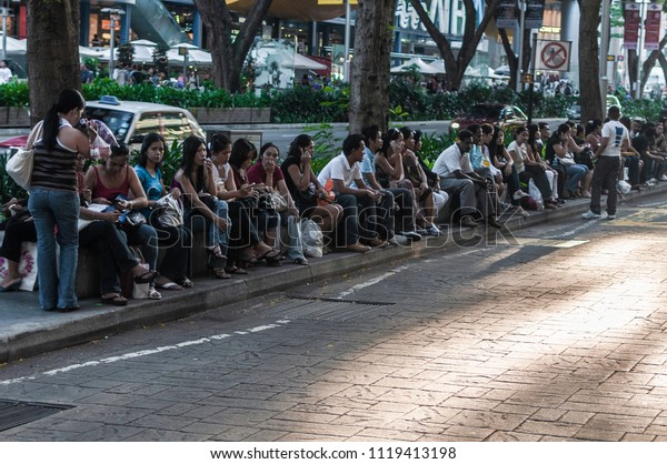 Overseas Filipino Workers on a Sunday day-off, Orchard Road, Singapore - 6 June 2010