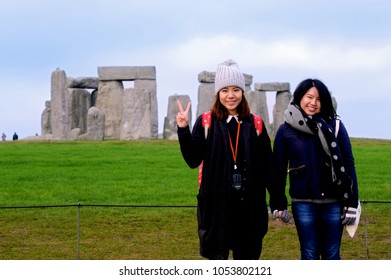 Overseas tourists, Stonehenge, England 2017. Tourists from Japan posing for a photograph at Stonehenge one of the most famous landmarks and tourist destinations in the U.K