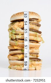 A oversized burger with a tape measure around it