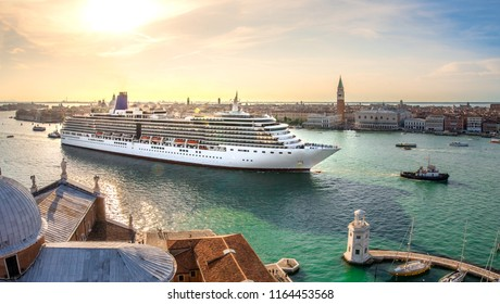 Oversized cruise ship brings thousands of tourists to venice, italy