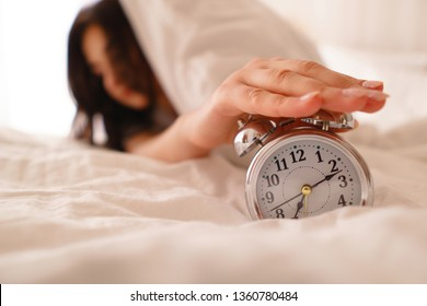 Oversleep woman waking up late turning off alarm clock. Morning routine, early awakening, lack of sleeping, time line concept