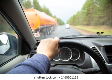 Overtaking car. Dangerous maneuver. Driving a car on the highway.