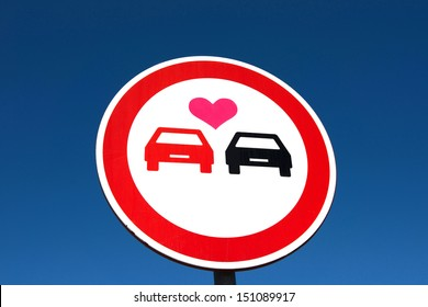 Overtaking sign with a love heart between the cars. Car lover