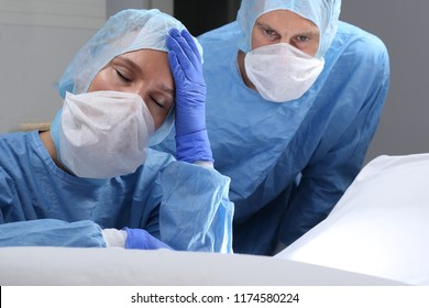A Overtired or angry doctor doing a surgery