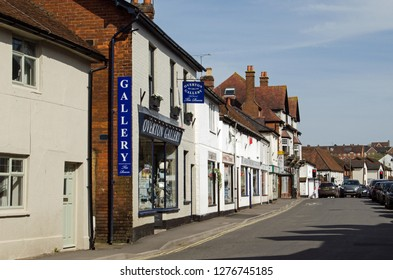 OVERTON, HAMPSHIRE, UK - APRIL 6, 2018: View along the High Street of Overton, Hampshire on a sunny Spring afternoon.