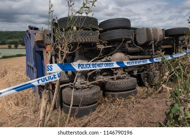 "Overturned Lorry on a Quiet Country Lane with ""Police Do Not Cross"" Tape in Rural Devon, England, UK"