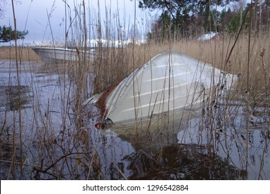 Overturned rowboat partly under flood water due to an extraordinary high sea water level at the Baltic Sea during a severe Autumn storm in Southern coast of Finland on November 10, 2017.