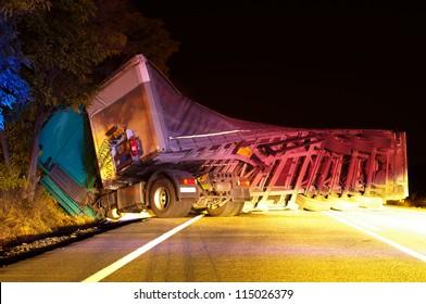 Overturned truck in crash. Night Photo