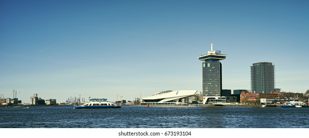 Overview of the Amsterdam IJ river with ferries, EYE Film Museum and ADAM Tower