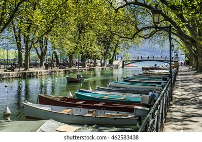 Overview of Bridge of loves in Annecy lake and channel with boats - France.