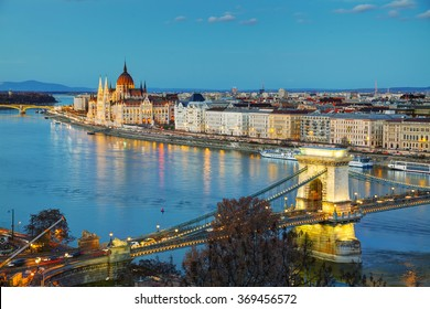 Overview of Budapest with the Szechenyi Chain Bridge at sunset